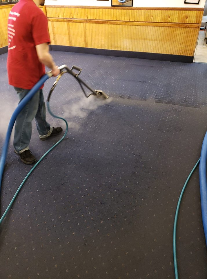 Employee Cleaning Carpets